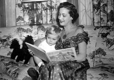 Dorothy Lamour reads to her son John