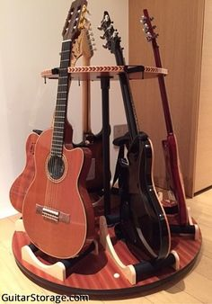 """""""I'm amazed at how much space I can save with this stand and still have all my favorite guitars displayed in the room. Here's a picture of how it looks like. Thanks for an excellent product!"""" - Read more at https://guitarstorage.com/shop/multiple-guitar-stand-carousel/"""