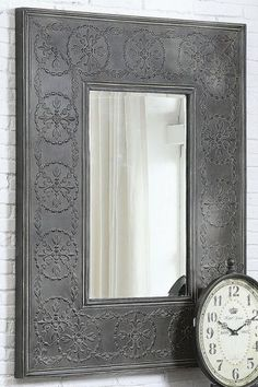 "Crafted of metal and glass.  Use as a entryway or bathroom mirror.  Size	48.75""Hx37""W  Color	CHARCOAL  Price	 $169"