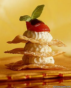 Wonton Napoleons: For these savory napoleons, wonton wrappers are sprinkled with coarse salt, baked, then layered with herbed ricotta cheese