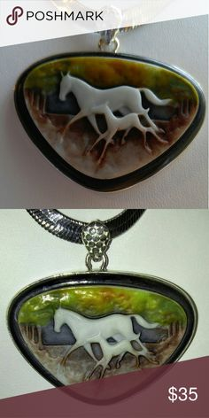 """Handcrafted Cameo of Mother and Foal Pendant Handcrafted Cameo of Mother and Foal running through the woods. Pendant is 2"""" long and set in Sterling Silver 925 hallmark. Another handmade, unique, one-of-a-kind piece of jewelry. Chain not included. Handmade Jewelry Necklaces"""