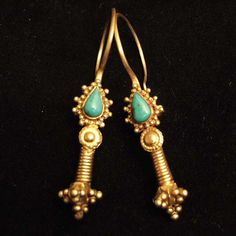 20ct gold, turquoises, Iran This type of earrings which can be found also in Afghanistan  is often  wrongly attributed to the Kazakh people. You can find this earrings with alternative  stones or glass pearls . Considering the very beautiful turquoises which decorate these earrings, I think that they probably come from Iran.