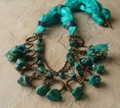 PaHaRa     Handmade Beaded Unique Jewelry by Hatice Rahn  on etsy -- hand-dyed silk cord, antique bronze chains and turquoise beads.