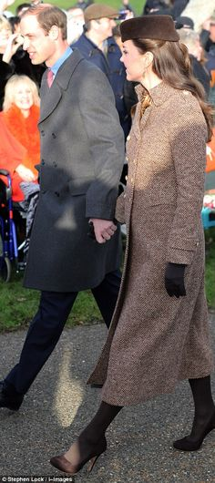 Christmas Day 2014 The look of love: Kate and William beamed at each other as they made their way to church h...