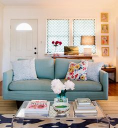 Light blue couch with navy rug