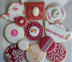Perhaps some of my favorite cookies . . . ever.  I LOVE her details on the burgundy cookies.  Oh my gosh!   Would put the pink teacups separately, but can you believe these are NOT decals, but hand painted!!!  What the heck!  These are bleeding GORGEOUS!!!
