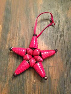 Paper bead Christmas ornaments made by women in Haiti! LOVE!