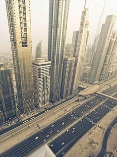A panorama with an aerial view of Sheikh Zayed Road (SZR), Dubai, UAE. Sheikh Zayed Road is a major highway which is flanked by Dubai's incredible skyscrapers Abu Dhabi, Dubai City, Dubai Hotel, Dubai Uae, Dubai Trip, Sharjah, Dubai Holidays, Cities, Visit Dubai