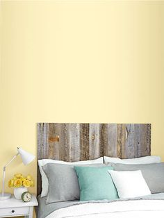 Create an instant headboard with Stikwood, reclaimed barn wood that boasts super-sticky backing -- no nails required!