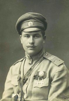 """Imperial Russian Army - High quality photo of service cap with oval cockade. Two Imperial Cross of Saint George Imperial Russian Medals on tunic. Order or badge on medal ribbons unknown. Shoulder boards clearly indicate """"3K"""" which may be 3rd Army Corps. Thick rank bar on shoulder boards indicate Master-Sergeant. Breast pocket flaps have shallow scallops. WW1."""