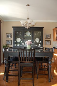 I love my dining room.  Buffet and Hutch  Dining table and chairs....looks like pottery barn but all of this was purchased at Stoney Creek Furniture. They have fabulous things there!