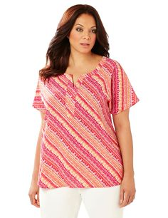 Sunset Stripe Tunic | Catherines  Vibrant sunset hues and a diagonal tribal stripe combine in this breezy tunic. Relaxed dolman sleeves and a hi-low hem keep this piece flowy, while the front placket adds texture. Catherines tops are designed for the plus size woman to guarantee a flattering fit. This style is available in both average and petite plus sizes. #catherinesplus #plussize #plussizefashion #petiteplus