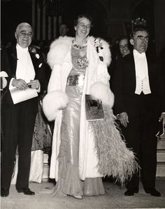 Eleanor Roosevelt attending one of the President's Birthday Balls. Her son Elliott is behind her on the right.