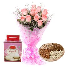Combo of triple sweets with flower and dry fruits.