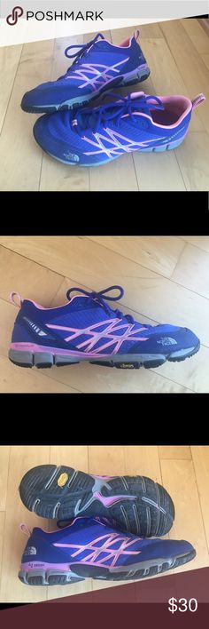 The North Face women's training shoes These are lightly worn training/trail/running shoes Women's Size 10.5, blue and pink Some wear in the mesh/netting toe area as shown Very comfortable! The North Face Shoes Sneakers