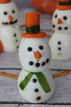 Egg Snowmen. Hard Boiled Egg Snowman Tutorial - Adorable snowmen as a healhty snack. Details and instructions on Frugal Coupon Living.