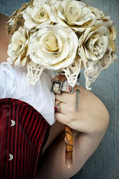 A sheet music bouquet, photo memorial, and a peek of a kick-ass corset? Bring this wedding on.
