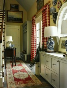 kitchen with big red checked curtains and oriental runner...nice mix
