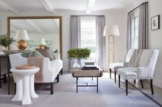 The use of burnished Gold, a little wood & an occasional antique, warm up this light, white, airy & modern room.