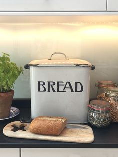 Simple Kitchen refresh - with styling and props ~ Incredibusy - classic bread bin, wooden chopping boards, mason jars, sour dough bread, all we need now is a Pole and Hunt knife!!