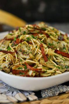 Spaghetti with Garlic and Oil (Aglio e Olio) with Artichokes, Crisped Salami and Pine Nuts
