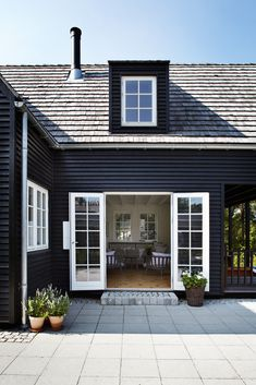 dark grey clapboard (weatherboard) and white windows