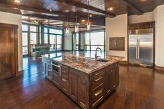 Luxury kitchen with maple cabinets, large center island and open floor plan design.