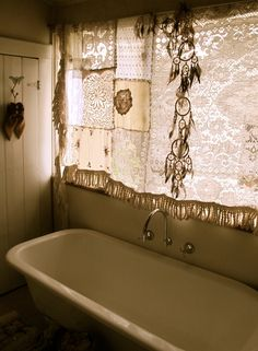 A lovely reuse of vintage lace & textiles in this bath
