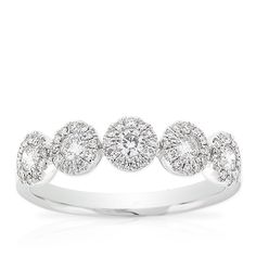 Halo design diamond ring, 1/2 carat total weight, in 14K white gold.