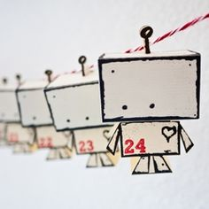 A free template and tutorial to make these cute little paper toy robots into an advent calendar.