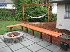 small backyard ideas- like the simple bench.  i like the hammock