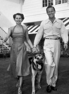 William Holden and Brenda Marshall at home with their Dog