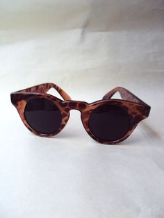 A fab pair of vintage sunglasses, with classic late 40s shape but made of earlier plastic material, so Id date them at around the 80s. In semi-trans
