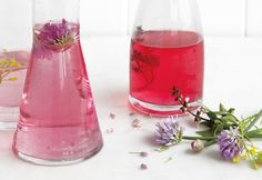 DIY Herb Blossom Vinegars ~~ Distilled white vinegar with various herb blossoms, such as elderflower, chive, and Thai basil, to make vinaigrettes and sauces