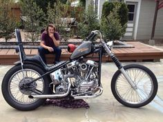 Panhead hardtail custom with tall king queen seat, low straight exhaust, 21-inch spool front wheel and fork gaiters