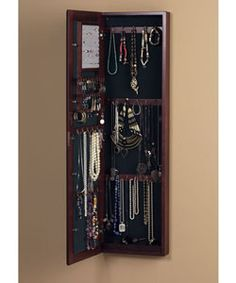 @Overstock - Jewelery mirror crafted of solid Chinese oakWall-mount jewelry mirror offers plenty of space to hold necklaces, bracelets, earrings, and ringsCabinet measures 14.625 inches wide x 4.125 inches deep x 48.125 inches tallhttp://www.overstock.com/Home-Garden/Wall-mount-Burgundy-Cherry-Jewelry-Mirror/2058292/product.html?CID=214117 $189.99