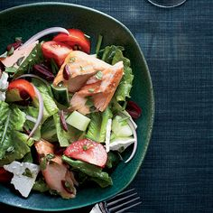 Greek Salad with Oregano-Roasted Salmon   People think a Greek salad is mostly vegetables and cheese, but by adding simply roasted salmon, it becomes a terrific main course.