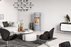 New standards for how you heat your home with fire stoves. We have a wide array of unique wood burning stoves drawn and made in Scandinavian design – RAIS Contemporary Wood Burning Stoves, Stove Accessories, Scandinavian Design, New Homes, Pure Products, Living Room, Elegant, Classic, Interior