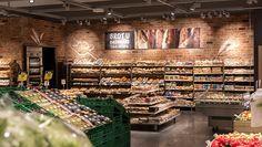 Neuerdings am Ladeneingang, neben Obst und Gemüse, werden Brot- und Backwaren vor einer Ziegelsteinmauer in Szene gesetzt. Das neue Ladenkonzept wurde vor der Umsetzung in einem Laborladen in Bern-Schönbühl getestet. Die gesamte Entwicklung dauerte rund zwei Jahre. Coop arbeitete im Ladenbau mit der Bolliger Söhne AG und der Schmidt AG zusammen.