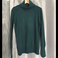 Listing! Mossimo Green Turtleneck Sweater Mossimo green turtleneck sweater. Approximately 25 inches total length, 20.5 inches armpit to end of sleeve, 19 inches armpit to armpit. Material 52% nylon, 48% rayon Mossimo Supply Co Sweaters Cowl & Turtlenecks