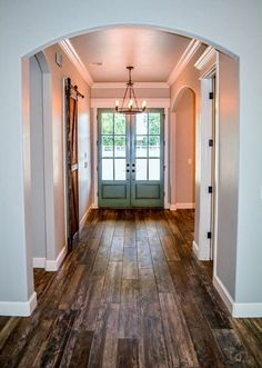 Farmhouse Entry -- barn style door to guest bath