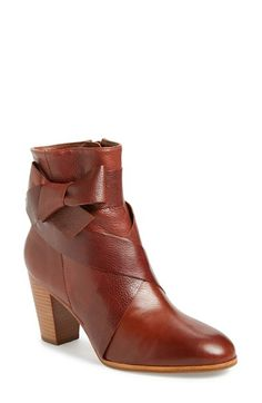 Free shipping and returns on kate spade new york 'tracee' bow bootie (Women) at Nordstrom.com. A stacked half-moon heel lifts a charming pebbled-leather bootie styled with wraparound straps that tie in a casually knotted bow at one side.