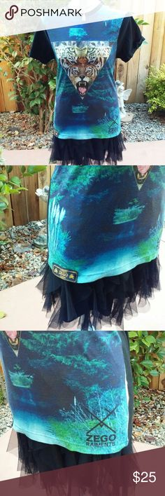 Zego Rainments Top Fashion forward Zego Rainments top. Wild animal graphics and multi color fabric. Skirt not included. Zego Rainments Tops Tees - Short Sleeve