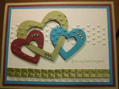 Hate the colors!  I'd like to try this with the heart in the middle and two ovals for rings as a wedding card.
