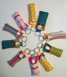 Wouldn't these make great stocking stuffers - Tutorial on sewing your own chapstick keychain. They are so adorable and make a great thank you, christmas gift, or stocking stuffer. Sewing Hacks, Sewing Tutorials, Sewing Crafts, Sewing Ideas, Sewing Patterns, Sewing Diy, Baby Sewing, Fabric Crafts, Diy Lip Gloss