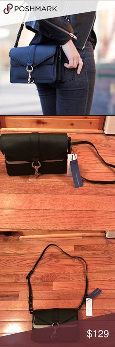 ON HOLD NWT Rebecca Minkoff Black Hudson Moto Mini Brand new with tags!! Rebecca Minkoff Black Hudson Moto Mini crossbody bag! Adjustable strap. Hardware is silver. Retail $265! No trades 😊 Rebecca Minkoff Bags Crossbody Bags