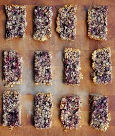 peanut butter and jelly granola bars on laying on a wooden board