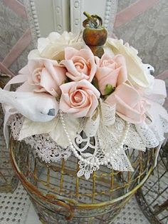 Angela Lace. Pretty !!  Could put this on top of a bird cage or lantern.