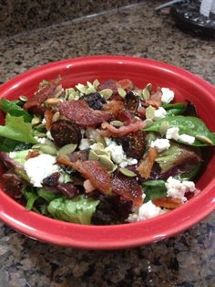 Dewey's harvest salad- Spring mix salad (or Field greens if you can find it), apple wood smoked bacon, roasted pumpkin seeds, dried figs, Boursin cheese (get the kind you can crumble not the spread), Apple vinaigrette- they make their own dressing but Girard's apple poppyseed is close
