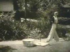 Bette Davis bathes her Scottish Terrier.